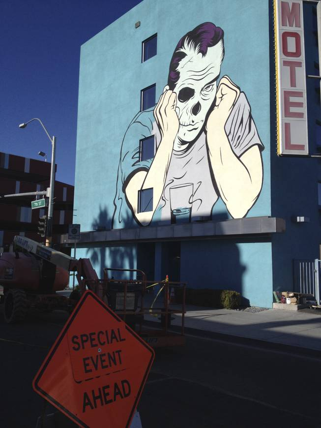 Work being done by D*Face on the wall of Cabana Suites, at 7th Street and Ogden Avenue.